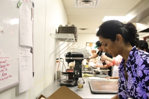 Nagree prepares an order alongside her employees at The Kitchen Space.