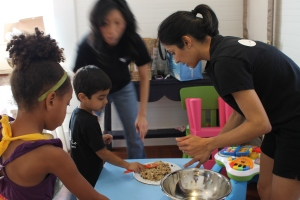 Nagree assists her son, 4, during a children's cooking class at La Patisserie.