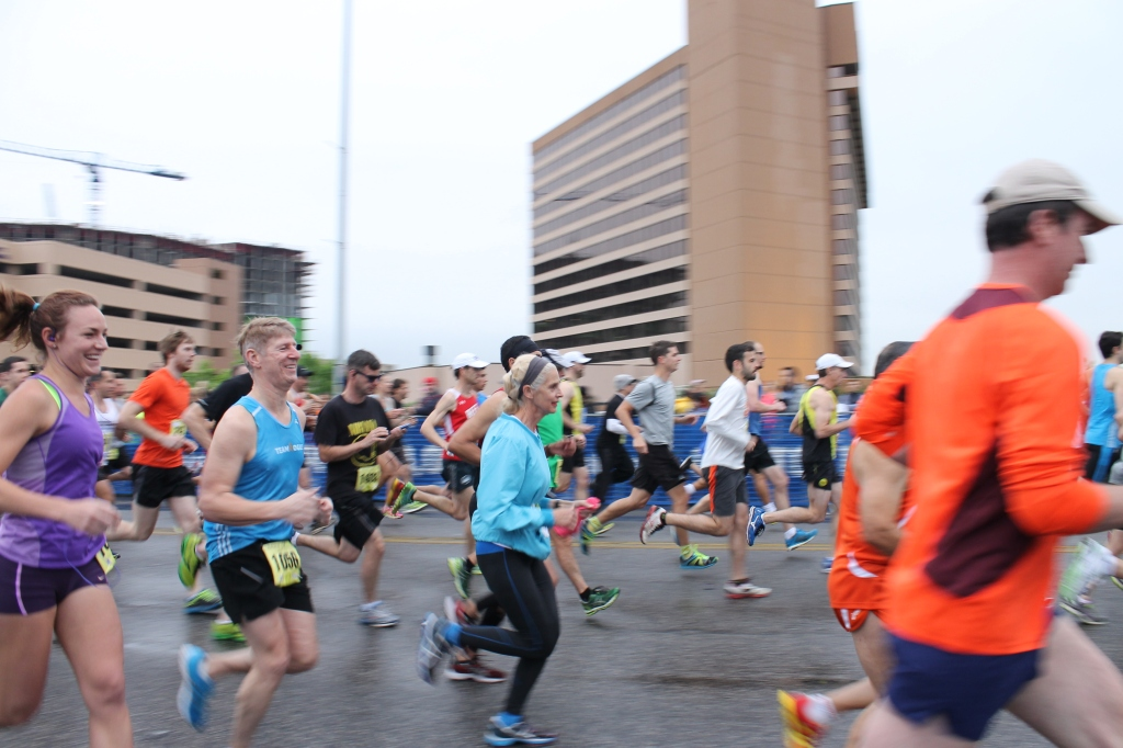 Runner make their way across the Ann W. Richards Congress Avenue Bridge.